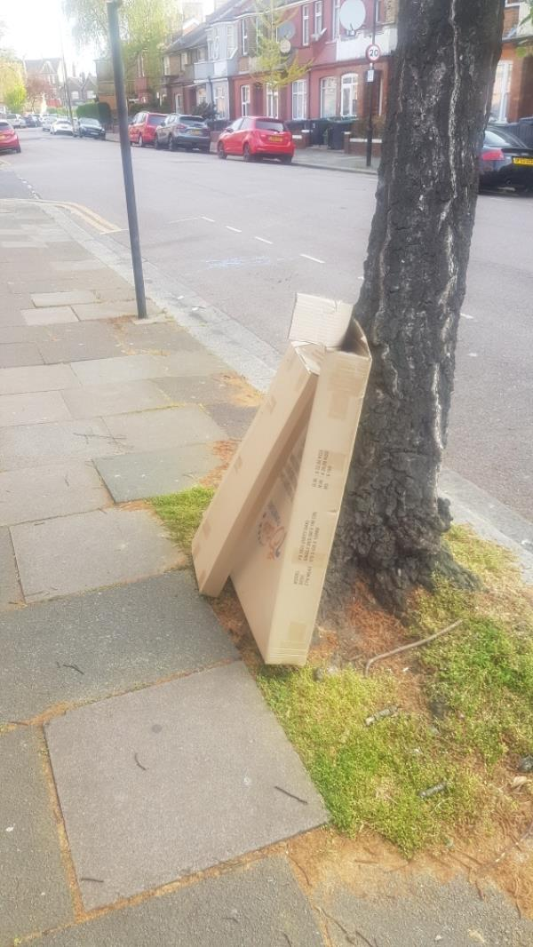 dumped rubbish fly tipping outside 43 mark rd-181 Russell Avenue, London, N22 6PY