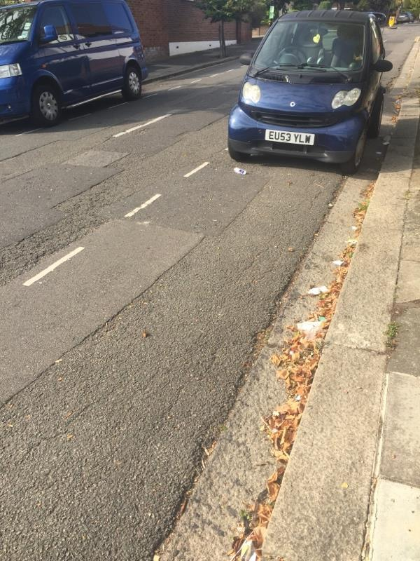 Extensive littering in vicinity of blue Smart car-50 Beaufort Road, Ealing, W5 3EA