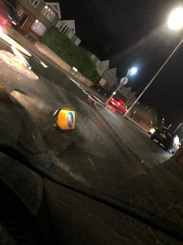 Road bollard smashed up and cannot see raised concrete by roundabout. Nor lit up. -2b Park Lane, Reading, RG31 5BD