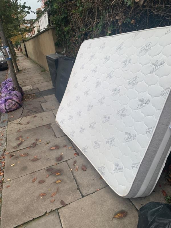 Dumped bed corner of Ravenstone road -41 Alexandra Road, London, N8 0PN