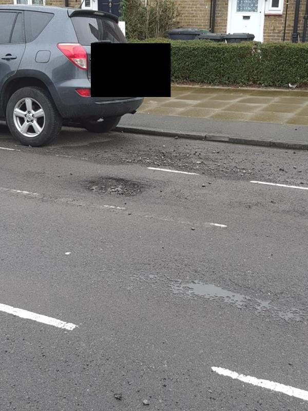 Pothole and loads of loose stones flying about from speeding cars-38 Henningham Road, Tottenham, N17 7DT