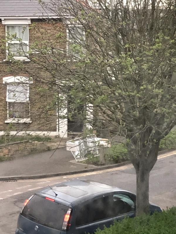 A mattress base, clothes hanger and various other items.-2 Wentworth Road, London, E12 5BD