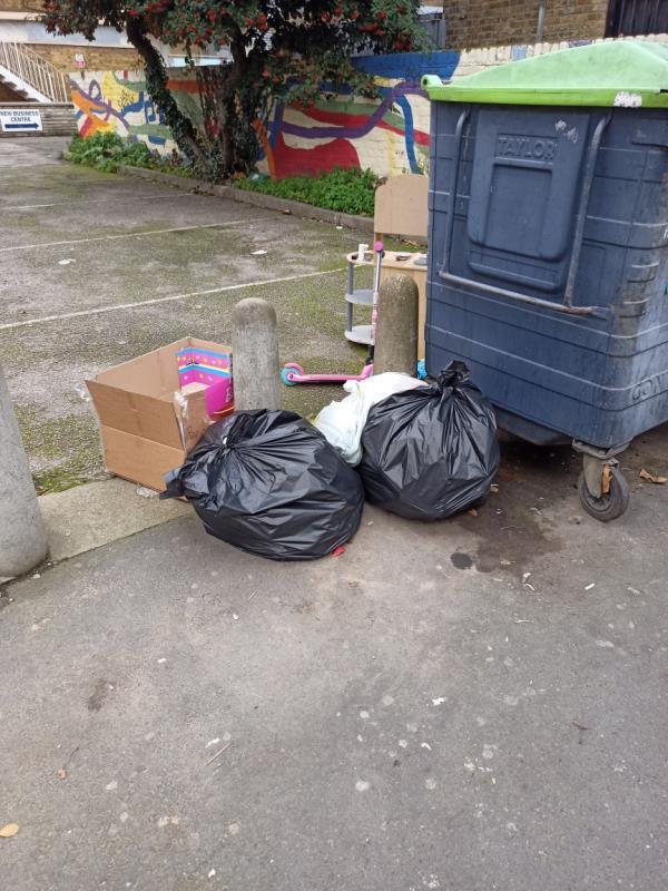 Bin bags left by wheelie bins-138 Earlham Grove, Forest Gate, London E7 9AS, UK