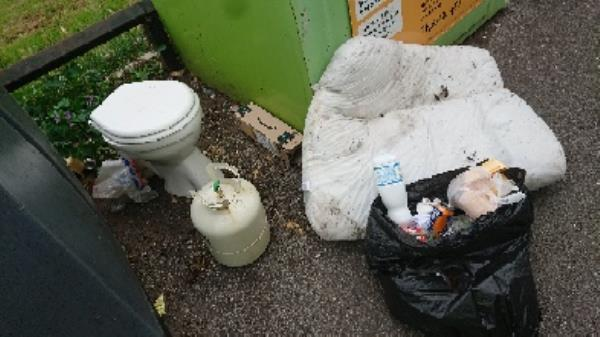 Builders waste. Houseold waste removedl fly tipping on going at this site -2-4 Deacon Way, Reading, RG30 6AZ