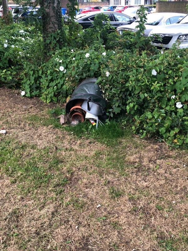 Somebody has dumped a garden bin full of rubbish next to the Brook by Kingsley Road-78 Kingsley Road, Farnborough, GU14 8SY