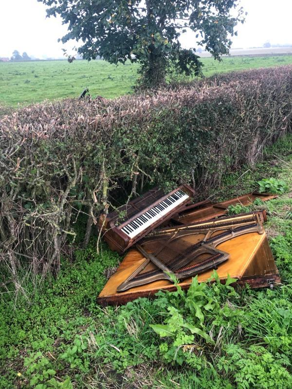 Fly tipped piano on Stamford lane, cotton Edmunds -The Lodge Stamford Lane, Chester, CH3 7QD