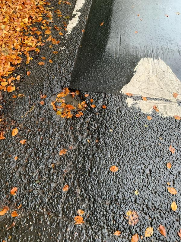 Pot hole on speed bump causing you to drive in middle of road.very deep hole .-70 Howey Lane, Frodsham, WA6 6DG