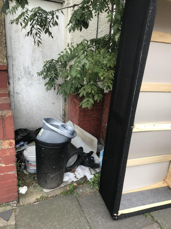 People dumping rubbish in this small open area, causing difficulties to pedestrian -94 Kitchener Road, London, E7 8JJ