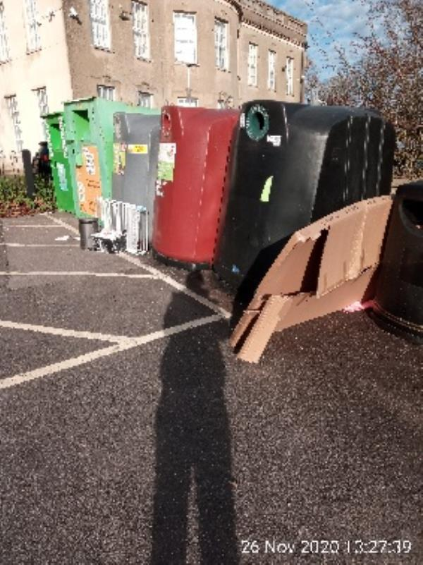 Rubbish at front and back of the bottle banks at coley Community centre. No evidence please clear. -2a Lesford Road, Reading, RG1 6DW