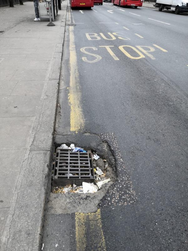 Very noisy drain cover and causing trouble to bus tyres.   Needs urgent repair. -304 Barking Road, East Ham, E6 1LA