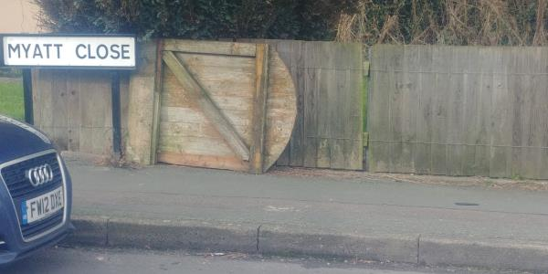 Wooden garden gate dumped by street sign-7 Myatt Close, Wolverhampton, WV2 2DJ