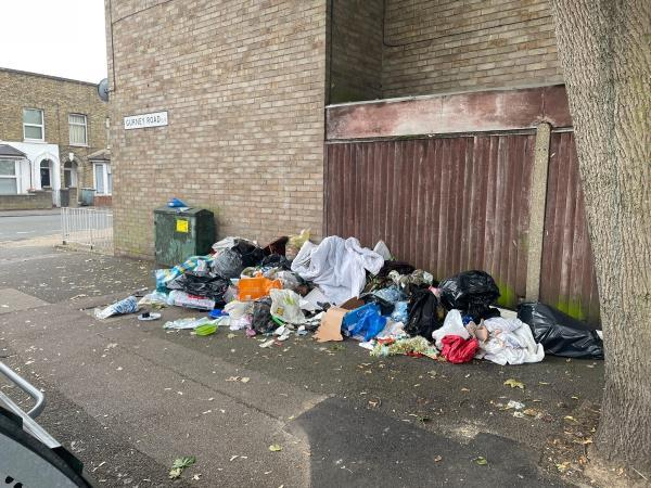 Big pile of rubbish on the pavement by the cycle store on Gurney Rd-19 Cruikshank Rd, London E15 1SN, UK