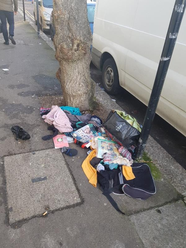 first ave romford road end, cloths dumped.-686 Romford Road, London, E12 5AJ