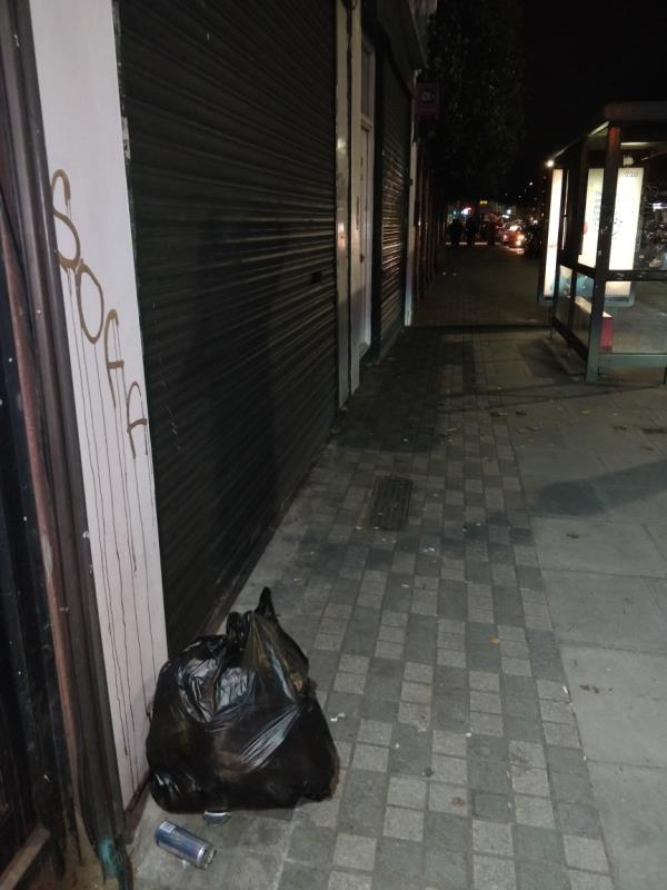 Dumped black bag of rubbish on the pavement beside 67 Leytonstone Road E15-67 Leytonstone Road, London, E15 1JA