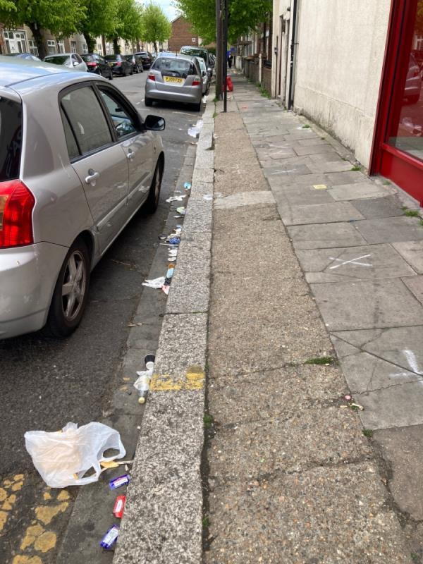 Whole road; strewn with litter - kings road-215 Boleyn Road, Green Street East, E7 8LE