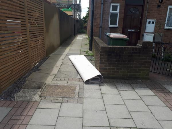 Carpet fly tipped on the footpath adjacent to 129 Chobham Road-129a Chobham Road, London, E15 1LX