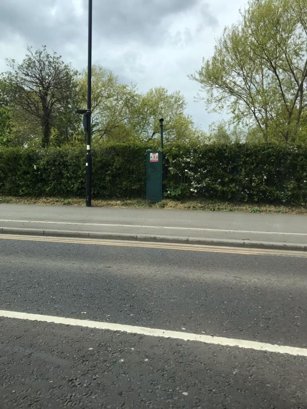 Black felt pen tags are located on a green metal cabinet on Ruislip Road East opposite junction Greenford Avenue W7 -Ruislip Road East, London, W7 3DD