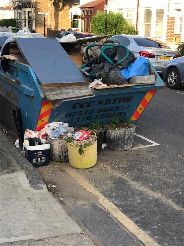 Another day, more crap left by this skip, do they have a permit? -55a Wilson Road, London, E6 3EF