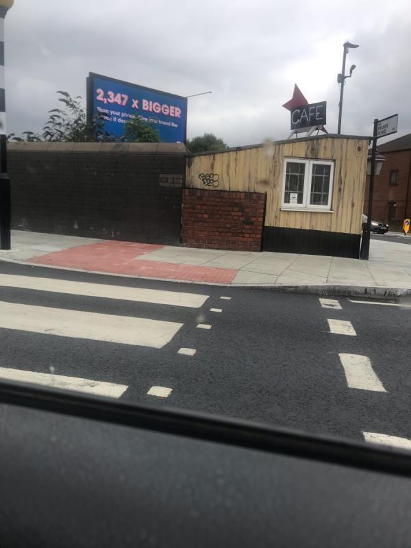 Spray painted tags are located on Harrys Cafe on Horn Lane junction Friary Road W3-Harrys Cafe Friary Road, Acton, W3 6AF