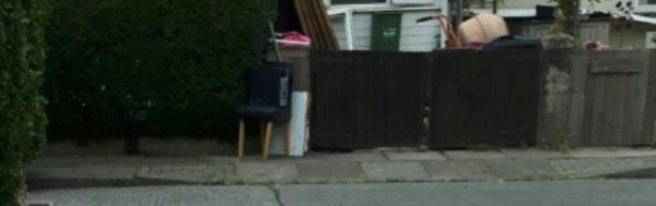 Computer tower chair and wood discarded on footway, it's been there for over a week.-5 Camfield Rise, Leicester, LE2 9BH