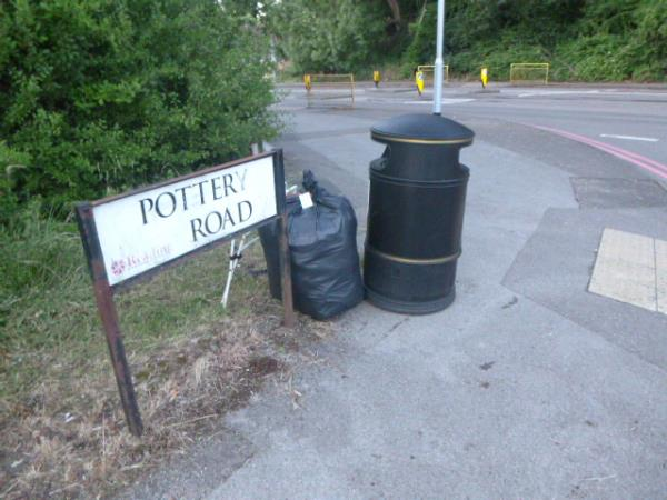 Another sack of rubbish from the abandoned camp site has been left by the litter bin in Pottery Road for collection.-180 Norcot Road, Reading, RG30 4UY