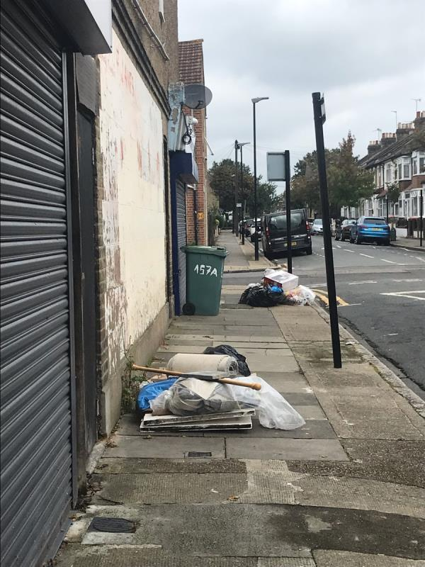 Two piles of rubbish-157 Wakefield St, London E6 1LG, UK