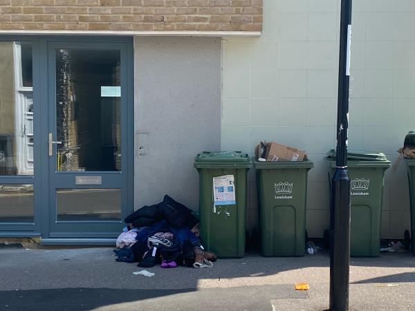 Clothes have been dumped on the street. -107 Tanner's Hill, London, SE8 4QD