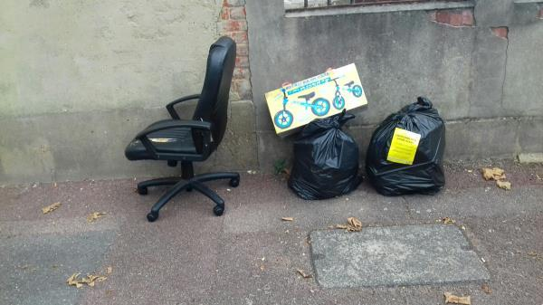 2 black bags of wastes and a chair dumped by Shoebury Road junction with Burges  Road -133 Burges Road, East Ham, E6 2BL