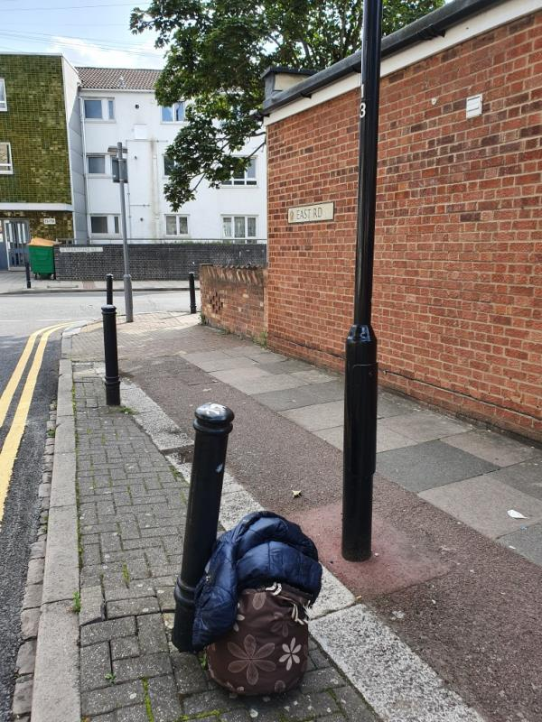Bag and a jacket left on a corner -102 East Road, London, E15 3QR