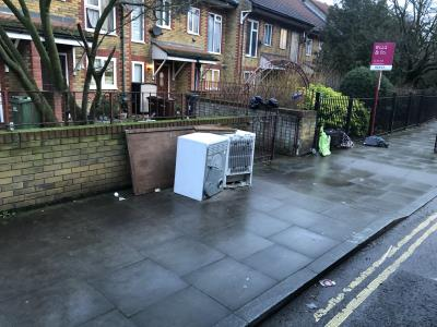 White goods (fridge and dishwasher)  left in street with suitcases and rubbish. Also some construction rubbish. -45 Springfield