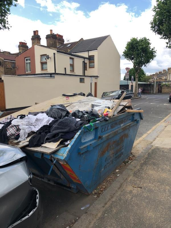 Flytipping in skip. This had been reported several times. The skip has been abandoned . This is in front of 24 Wilson Rd E6 3EF. The skip belongs to the garage on the side. You can see the chemical toilet of the building site from the road. Please address the issue.-24 Wilson Road, London, E6 3EF