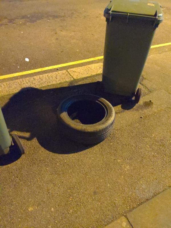 Fly-tipped tyre outside number 91 Springbank-81a Springbank Road, London, SE13 6SS