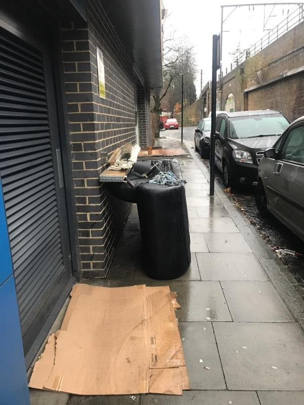 Rubbish outside flats/office sofa has been here all week-4 Andre Street, London, E8 2AD