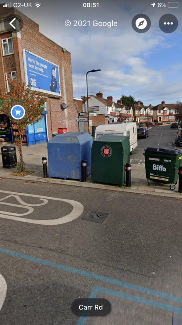 White spray painted tag is located on a blue recycling bin on Currey Road junction Wadham Gardens ub5-112 Currey Road, Greenford, UB6 0BX