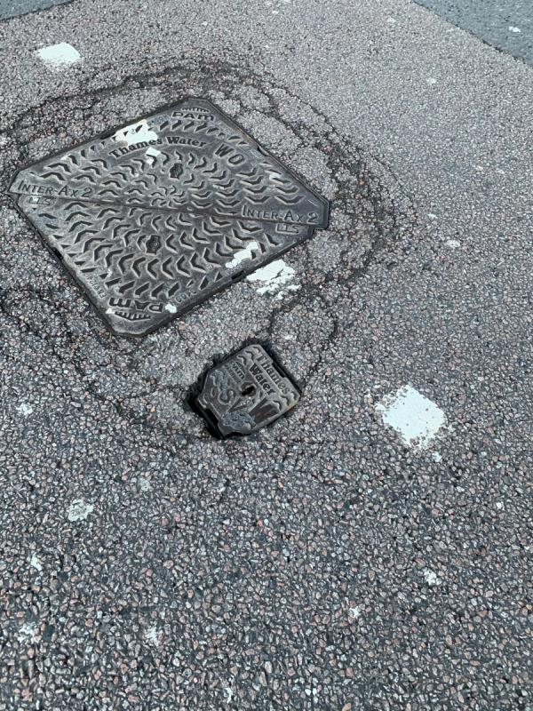 The manhole cover is sinking and the small lid is loose. This a trip hazard as is it on the pedestrian crossing.  image 1-Manhattan Loft Gardens, 18 International Way, London, E20 1DB