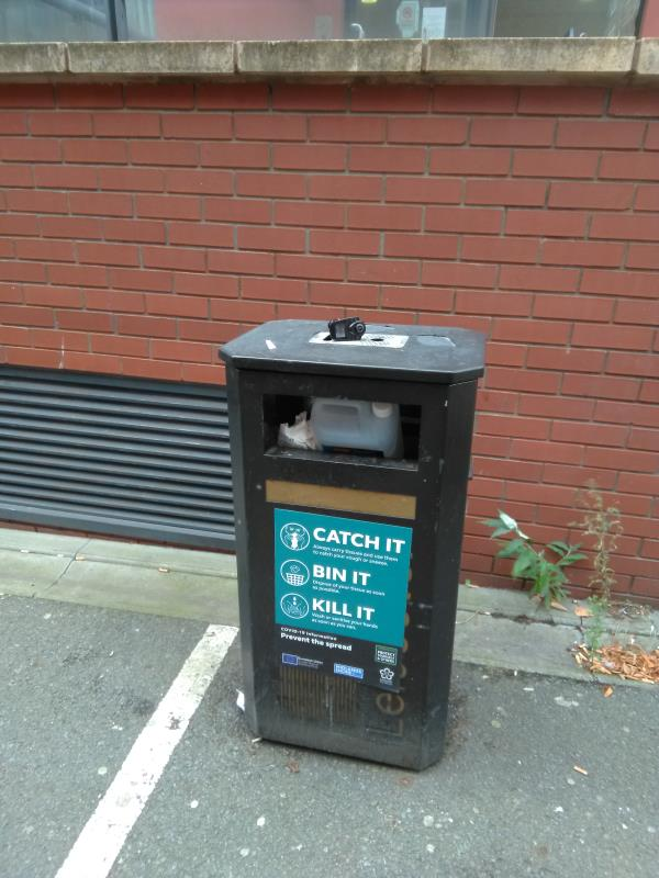 Street litter bin next to 3 Colton Square is overflowing.-3 Colton Square, Leicester, LE1 1QH