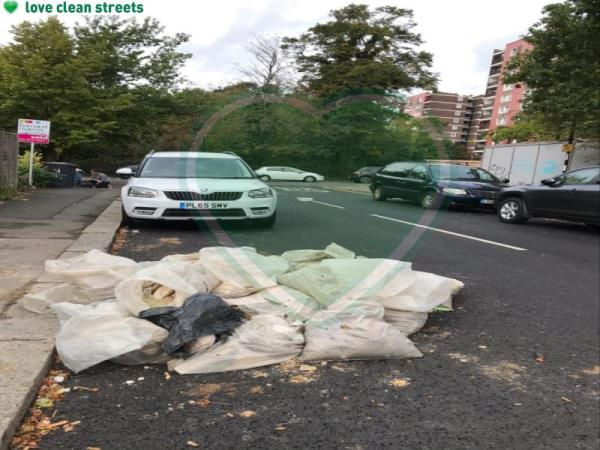 Approx 30 bags of rubble on the road at de frene rd junction mayow Rd -71A Mayow Rd, London SE26 4AA, UK