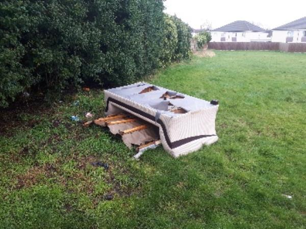 broken settee dumped on grassed area next to public right of way -102 Green Park Drive, Wolverhampton, WV14 6DU