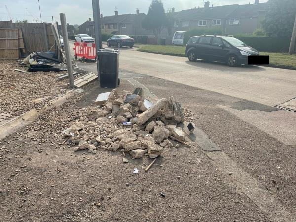 Rubble and other mess left on pavement at location.-18 Monmouth Drive, Leicester, LE2 9RJ