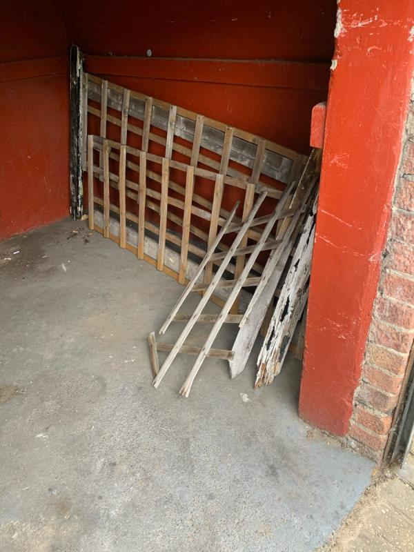Wood underneath the shutter in falcon street car park needs clearing up ASAP please -89 Falcon Street, Plaistow, E13 8DE