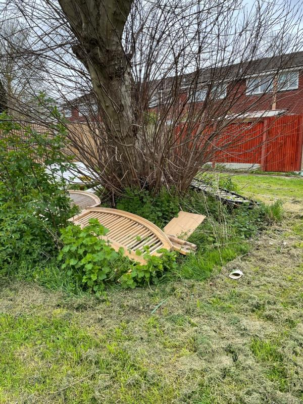 A wooden bed and various other objects appeared under the tree overnight 9/10th April. -43 Barnwood Close, Reading, RG30 1BY