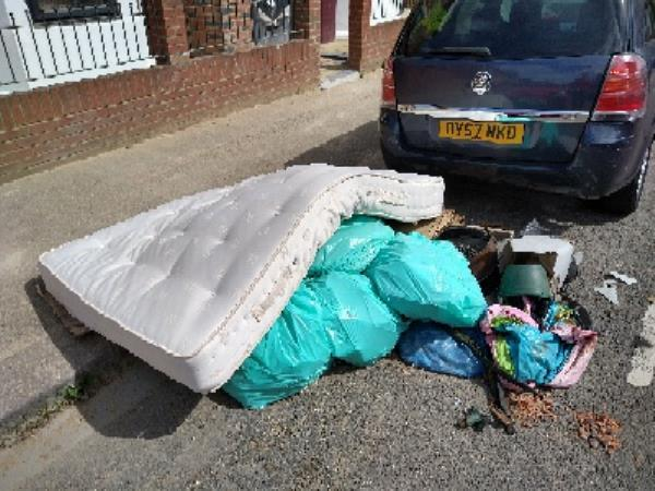 pile of fly-tipping on the road-29 Manchester Road, Reading, RG1 3QE