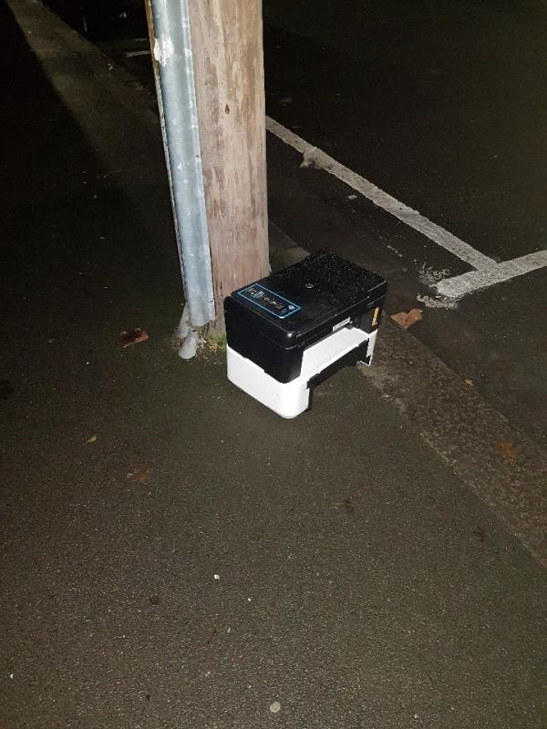 printers dumped in the middle of the road, next to a telephone pole.-104 First Avenue, London, E12 6AL