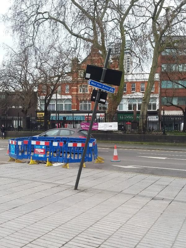 Bent roadsign at this location-43-45 Broadway, London, E15 4BQ