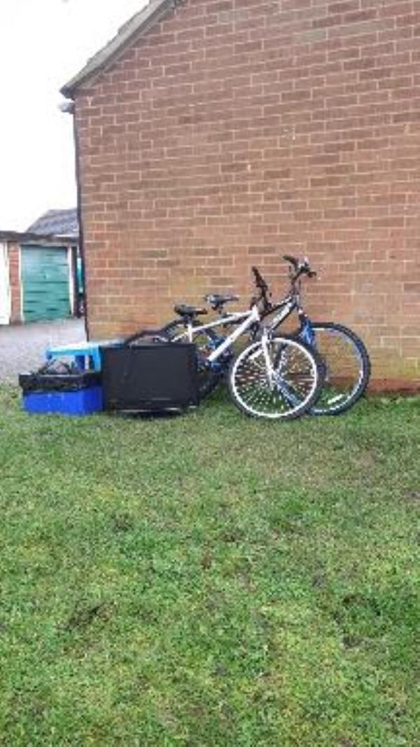 Two pushbikes, one TV, one kids table and a box of bits fly tipped.-35 Minton Close, Reading, RG30 6ET