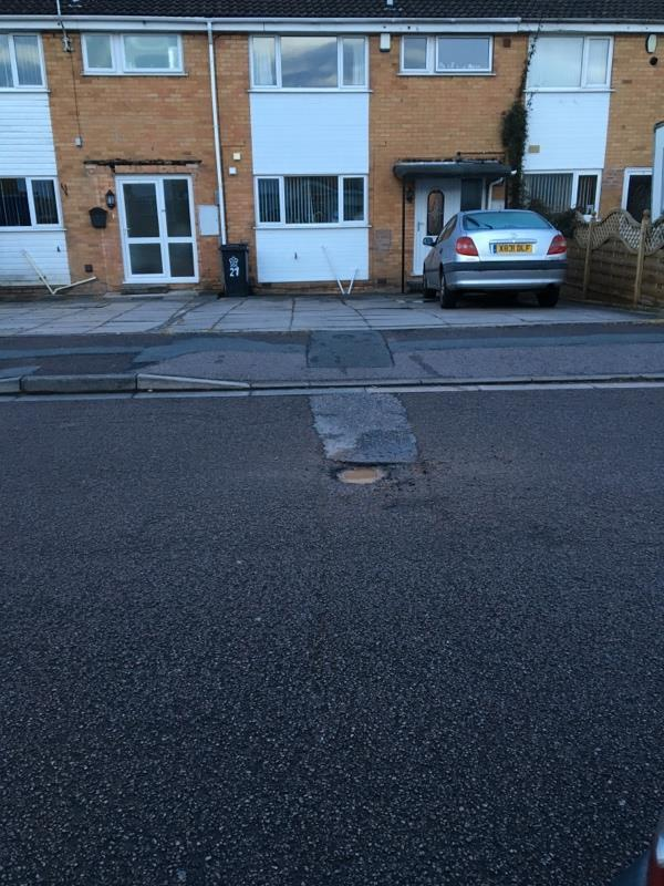 Pot hole outside no 22 Alderton close. Quite deep and will damage car tyres-49 Alderton Close, Leicester, LE4 7RN