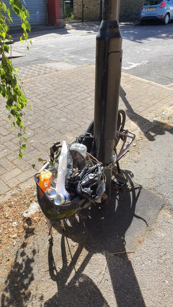 litter in locked bike basket -46 Windsor Road, London, E7 0QX