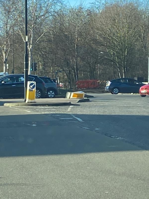 Keep left bollard in Windsor Terrace at Asda Roundabout junction knocked over and damaged -1 Woolwich Manor Way, London, E6 5NT