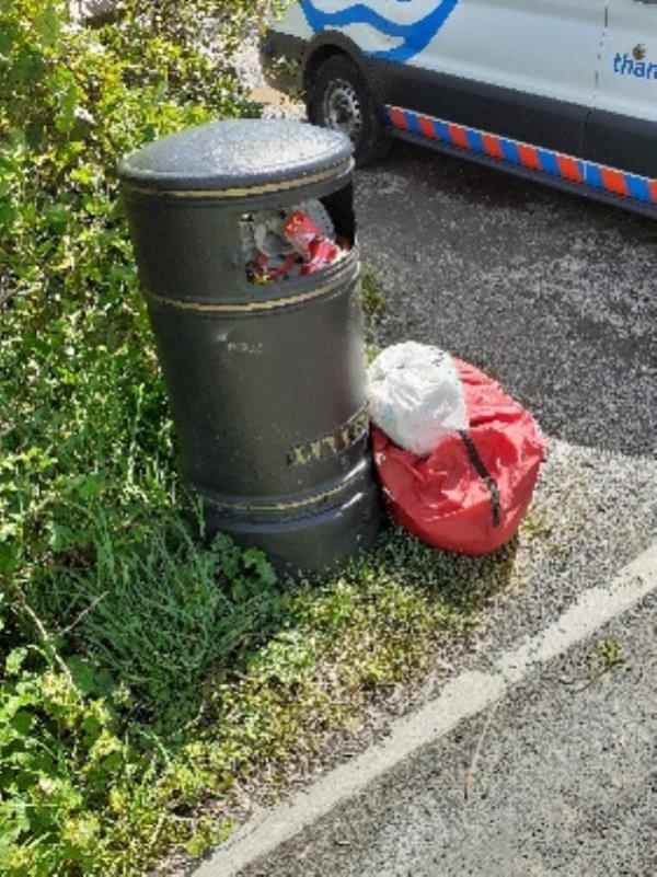 flytipped household waste in and around bin no evidence taken -93 Circuit Lane, Reading, RG30 3HH