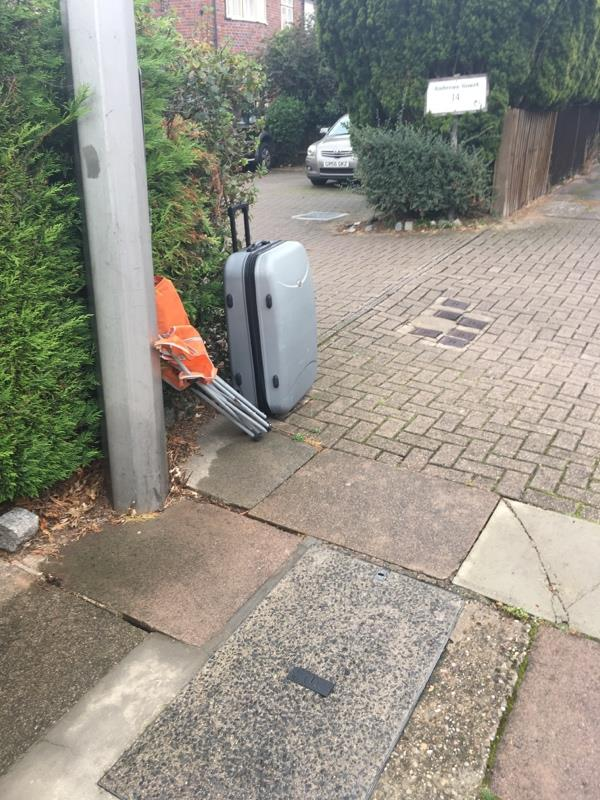 Fly tipping of chair and suitcase on Belvoir Drive, Aylestone. Located outside Belvoir Court. -31 Belvoir Drive, Leicester, LE2 8PA